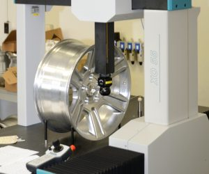 Coordinate Measuring Machine with machined aluminum wheel loaded for measurement