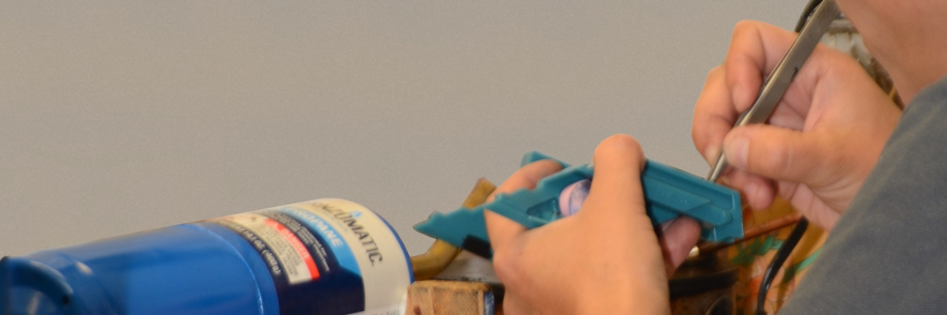 Employee works with wax pattern for investment casting