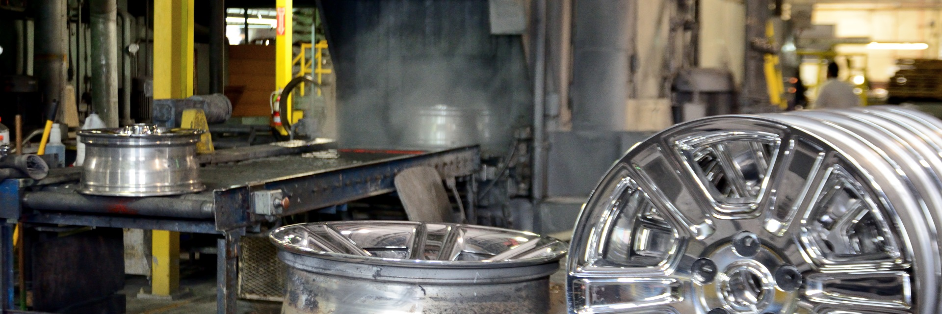 Wheels waiting to run through automatic washing and degreasing machine