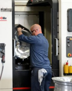 A blank wheel being loaded into a high-speed horizontal machining center for machining